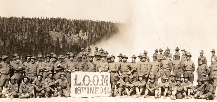 Members of the 18th Infantry 941 in front of Old Faithful geyser, 1912.