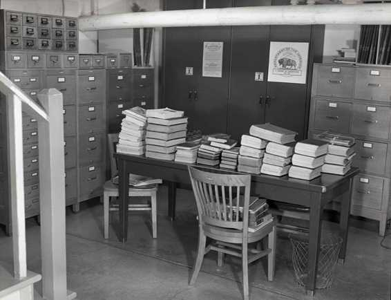 Unprocessed archival records await processing, circa 1965. Photo YELL 38654.