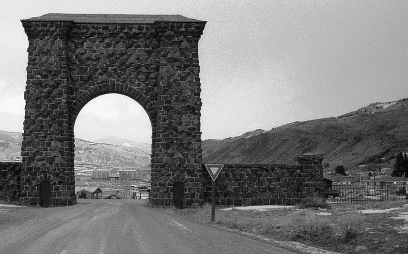 Yellowstone's Heritage & Research Center as seen through the Roosevelt Arch, photo by Elise Fariello, 2015.