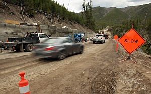 Travel through Gibbon Canyon continues along the old route as work on the new bridge nears completion