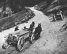 "(YELL 21158) Early road construction work in Yellowstone National Park. The vehicles pictured are ""Drop Belly"" wagons similar to those in the museum collection."
