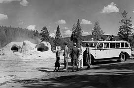 (YELL 90071-2) Northern Pacific Railway photo of 1936 Model 706 National Park Bus with visitors at Grotto Geyser.
