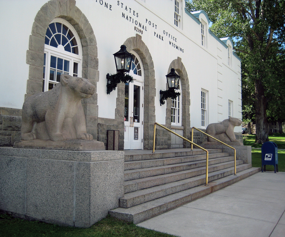 Two rock bears flank an entrance to building with several stairs