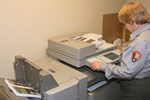 Employee using photocopier.