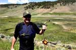 A bear management specialist holds the radio collar dropped from a bear.