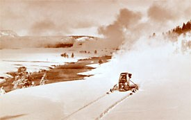 Historic photo of a snowplane along the Firehole River.