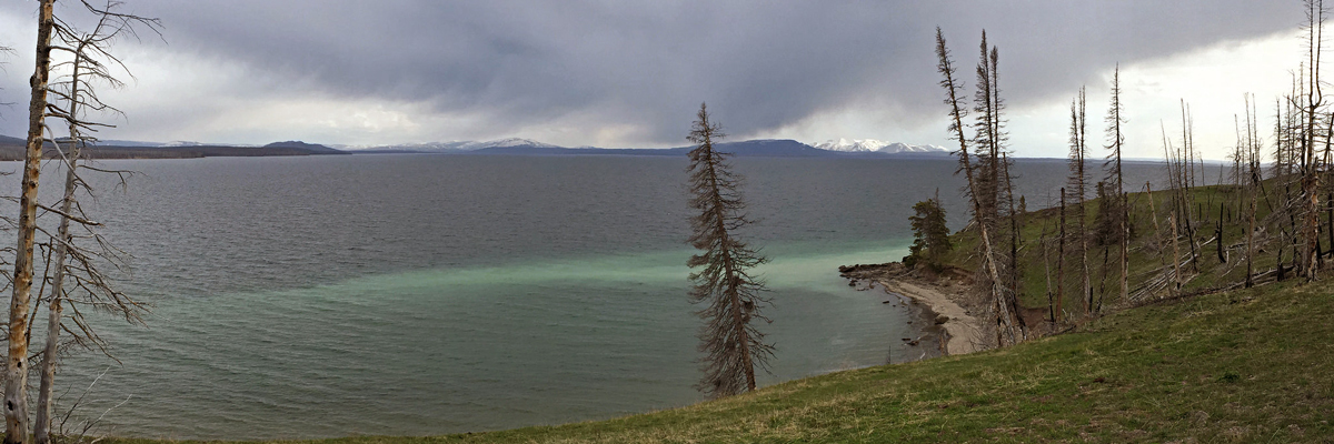 Clouds hover over choppy water on Yellowstone Lake