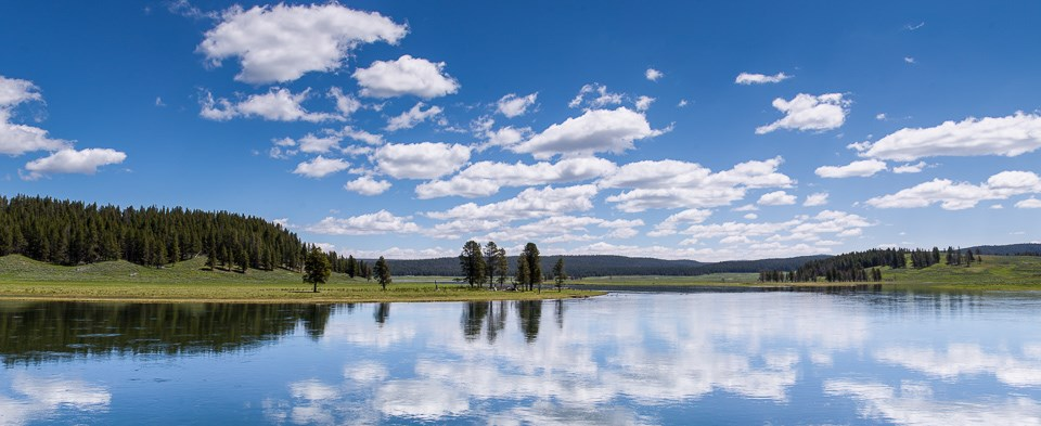 Panoramic view of Yellowstone river with reflected sky.