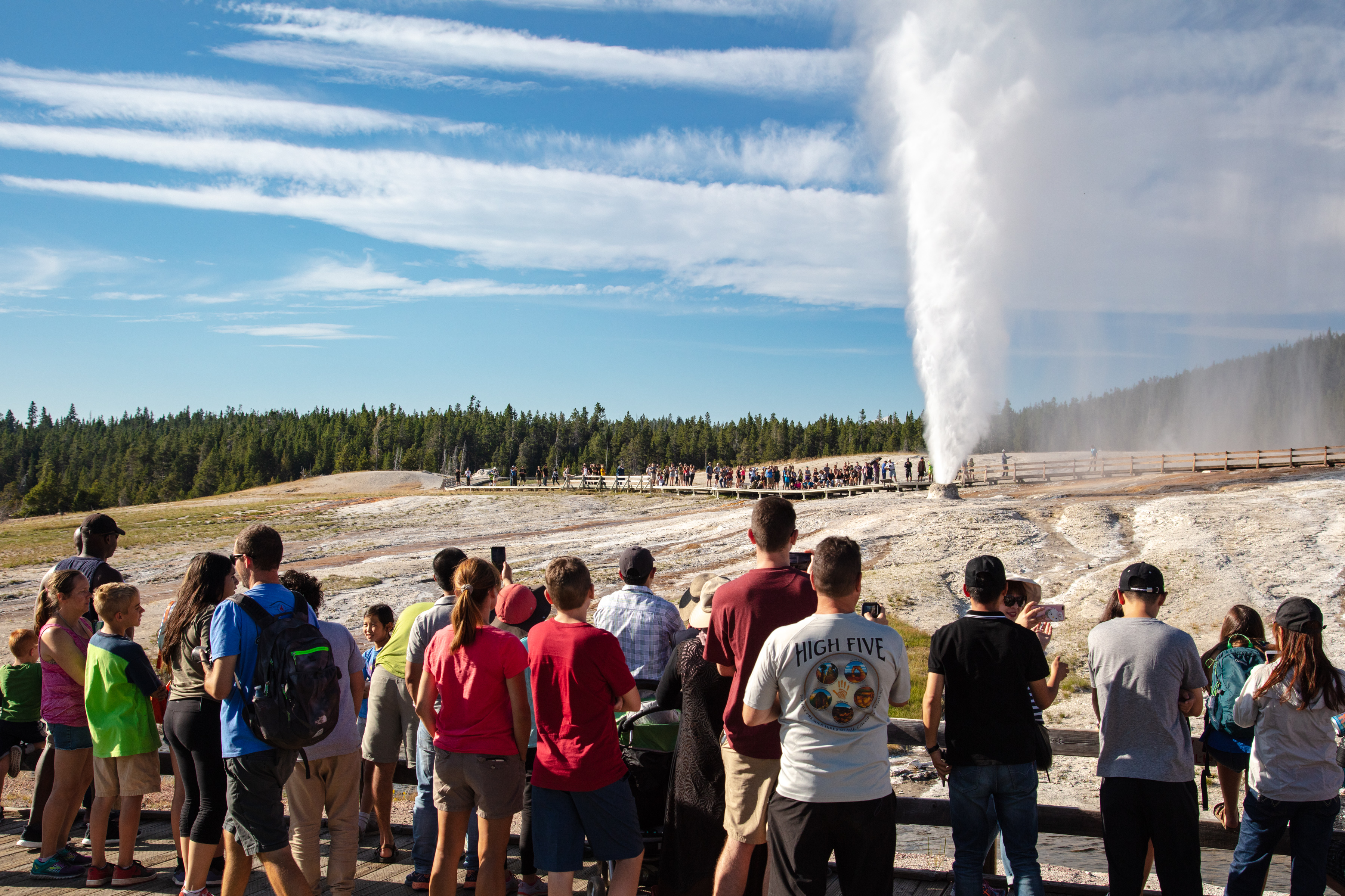 Visitors watching a geyser erupt