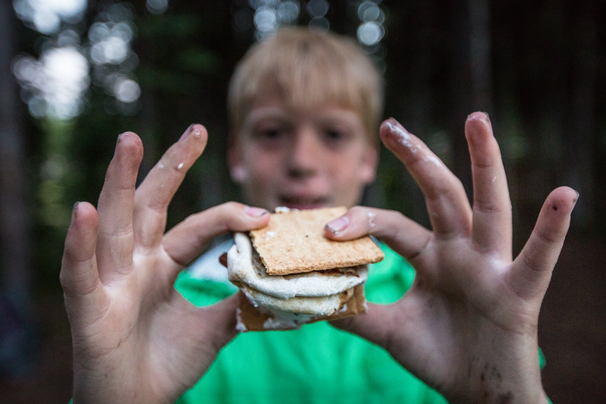 Boy holding up smores