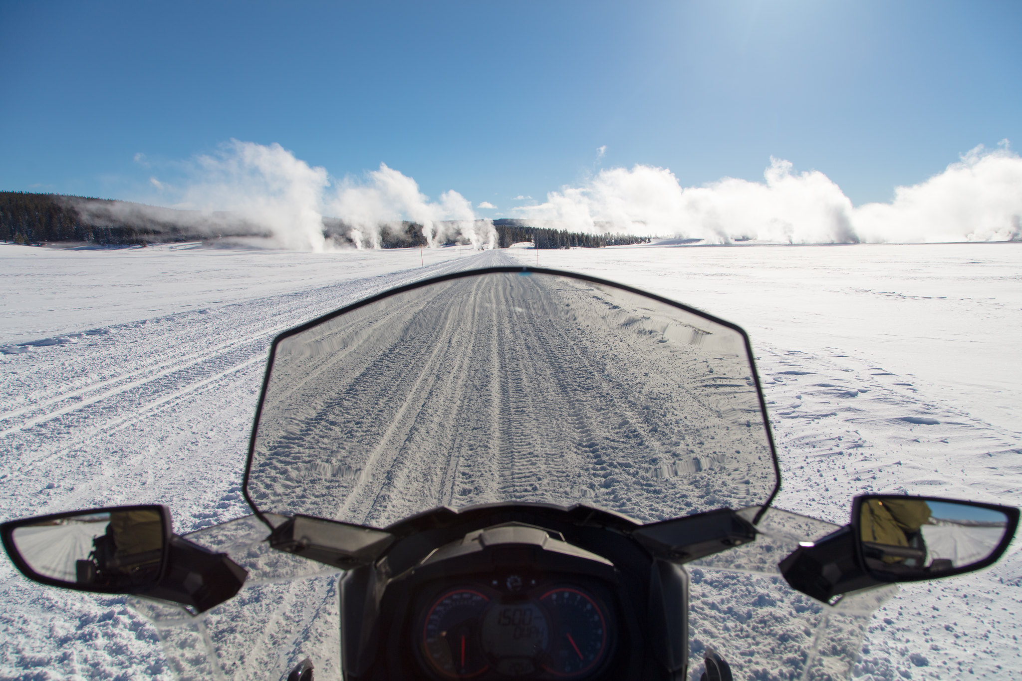 view from a snowmobile on a winter road