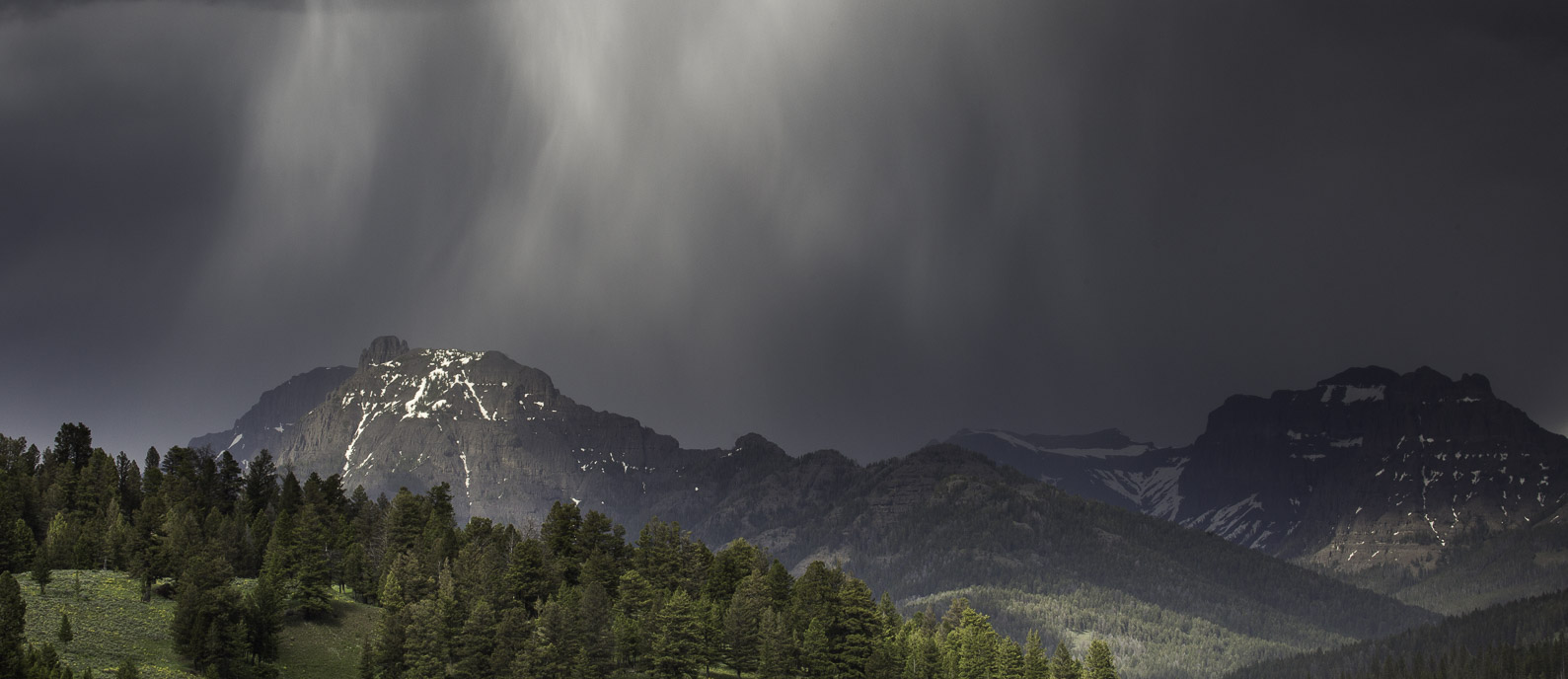 A photo of a summer storm over the Absaroka Mountains.