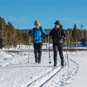Two visitors nordic skiing