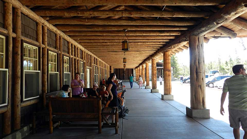 Visitors on the porch of Old Faithful Lodge