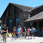 Visitors walking into the front door of Old Faithful Lodge