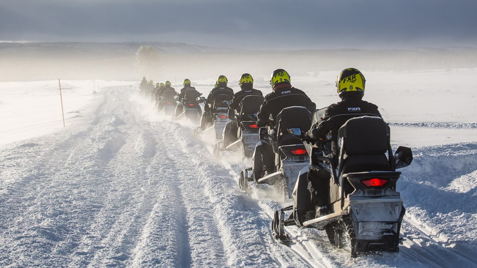 Snowmobile tour at Swan Lake