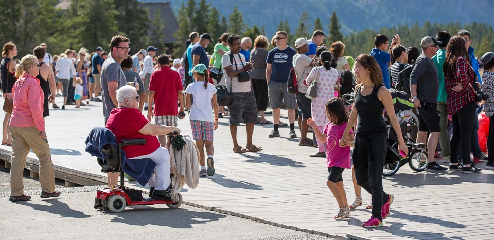 Motorized wheelchair on the boardwalk near Old Faithful