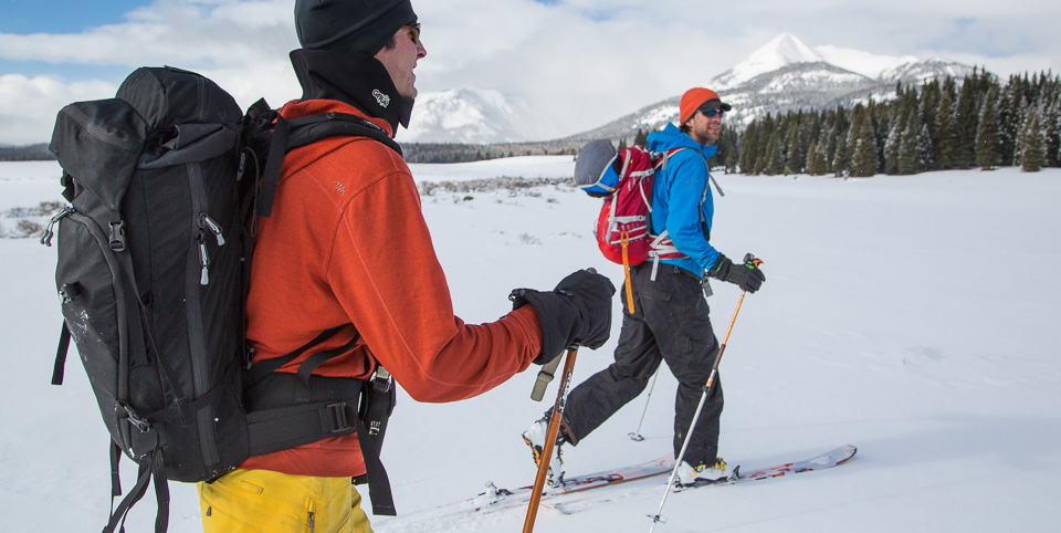 Two skiers heading into the Gallatin Mountains