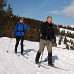 Two visitors cross country skiing.