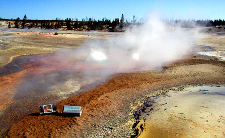 Whirligig Geyser begins to erupt amidst the orange-yellow iron oxide deposits surrounding it in Porcelain Basin.