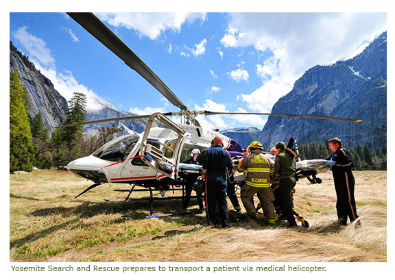 Yosemite Search and Rescue prepares to transport a patient via medical helicopter.