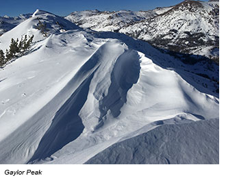 From atop a peak, a view of more snowy moountain peaks