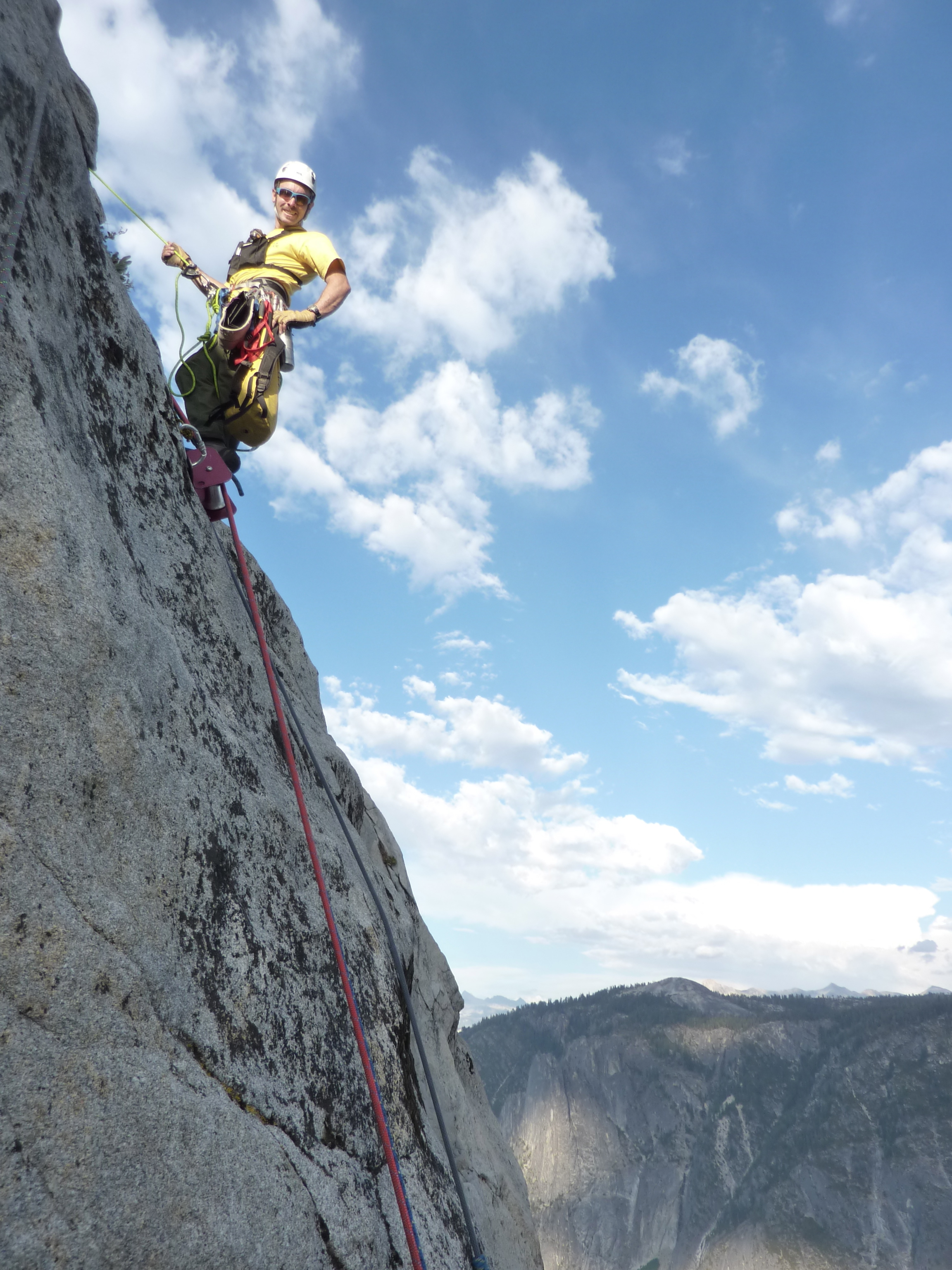 Search and Rescue employee rappelling down El Cap during a rescue.