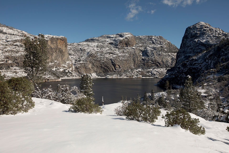Cliffs and reservoir at Hetch Hetchy covered in snow