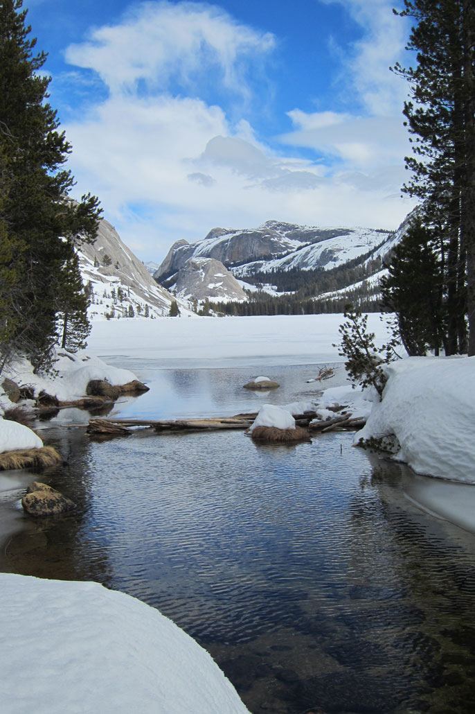 Snow-covered lake with domes in background