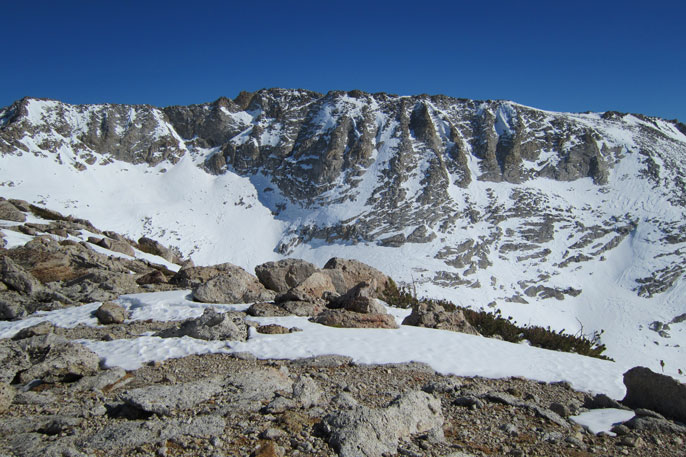Wind-swept partially snowy ridge