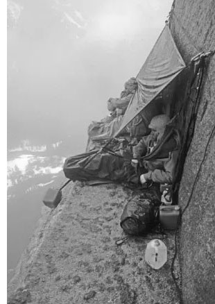 Bivouacing on a ledge in stormy weather