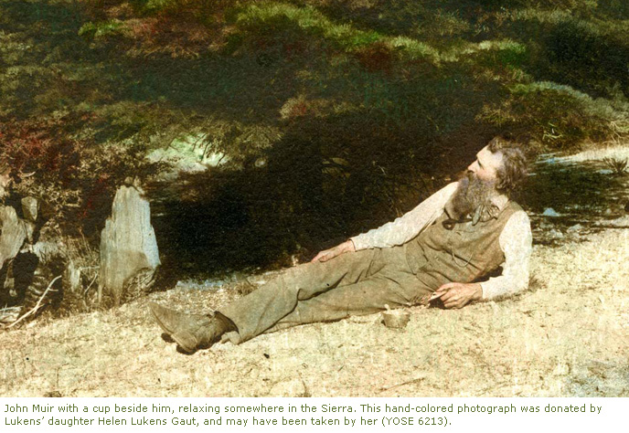 Photograph of John Muir with a cup beside him, relaxing somewhere in the Sierra. This hand-colored photograph was donated by Lukens' daughter Helen Lukens Gaut, and may have been taken by her.