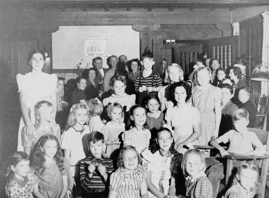 Group of about 30 white children and adults