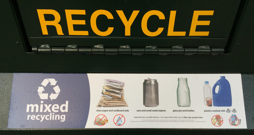 Sign showing mixed recycling can and associated symbols of what is expected in there.