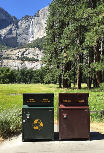 New recycling and garbage cans in Yosemite Valley with Yosemite Falls in background