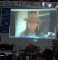Ranger video-chatting with students in a classroom