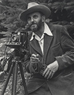 Portrait of Ansel Adams with a camera