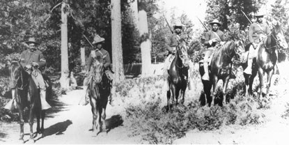 Black soldiers in the U.S. Army sit on horseback