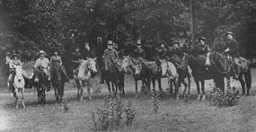 Pioneers on horseback pose for a photo