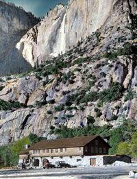 Hand-colored slide showing Yosemite Museum with Yosemite Falls in the background
