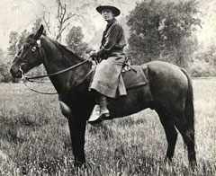 Female ranger riding horseback