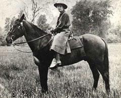 Female ranger riding horseback