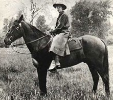 B&W photo of ranger Clare Marie Hodges on horseback