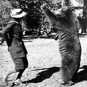 B&W of Enid Michael dancing with bear