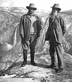 Muir and Roosevelt stand on an overhanging rock