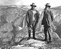John Muir stands on Overhanging Rock with President Theodore Roosevelt