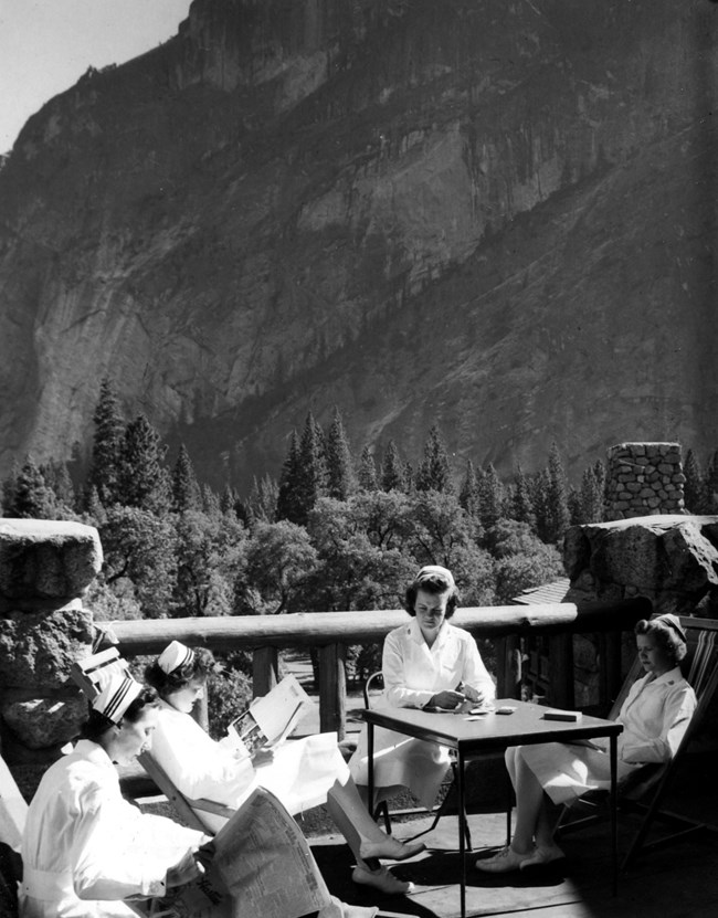 Nurses for the wartime hospital relax on a porch