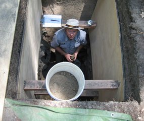 Archeologist in an excavation pit