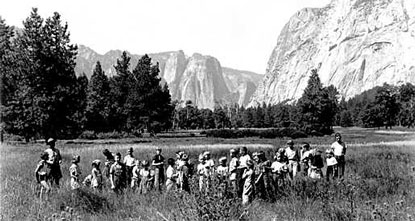 Ranger in Yosemite Valley field with children in historic photo