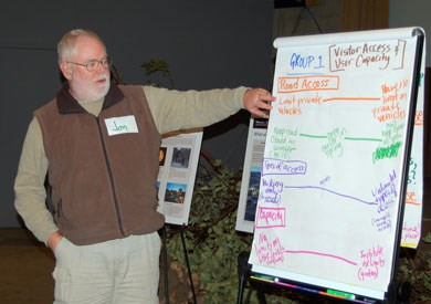 Participant at Feb. 10 public workshop presents possible planning sideboards as part of group exercise.